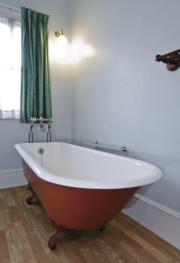 Retro alloy bath tub. Vintage alloy bath tub detail with white glaze stock photography