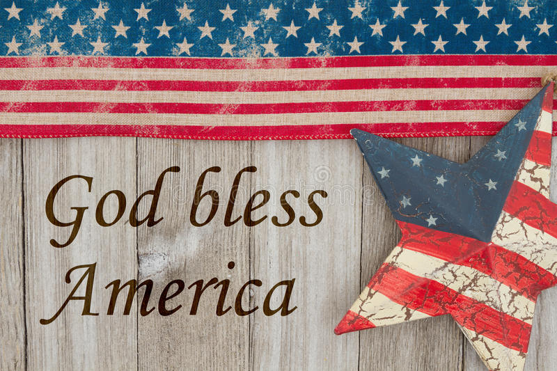 Retro America patriotic message with star. America patriotic message, USA patriotic old flag and a star and weathered wood background with text God Bless the USA royalty free stock images