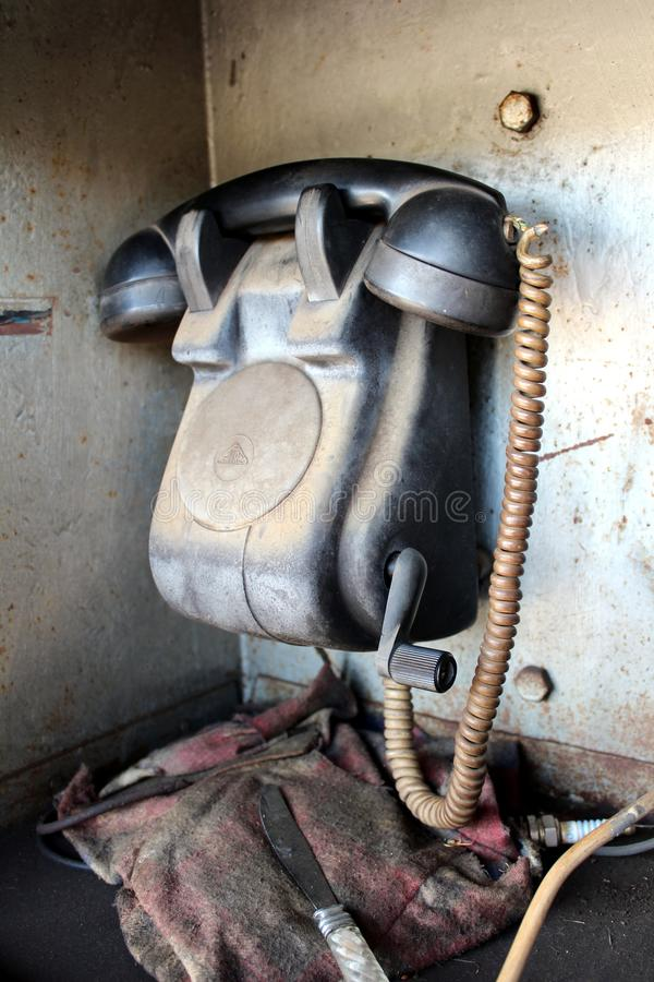 Retro black telephone communication device used for railway station communication with hand crank mechanism put in metal box stock photo