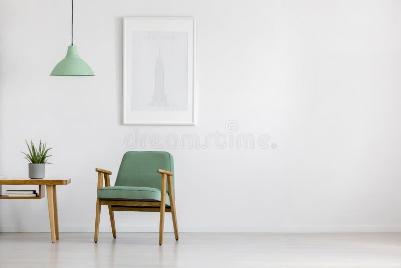 Retro armchair in bright interior stock photo
