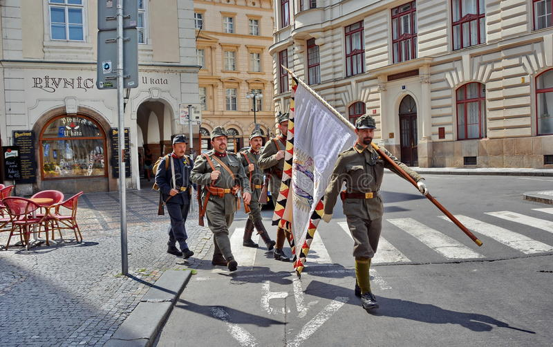 Retro army parade. Military in old uniform and with weapons systems, flag and accesories in Prague, Czech Republic royalty free stock image