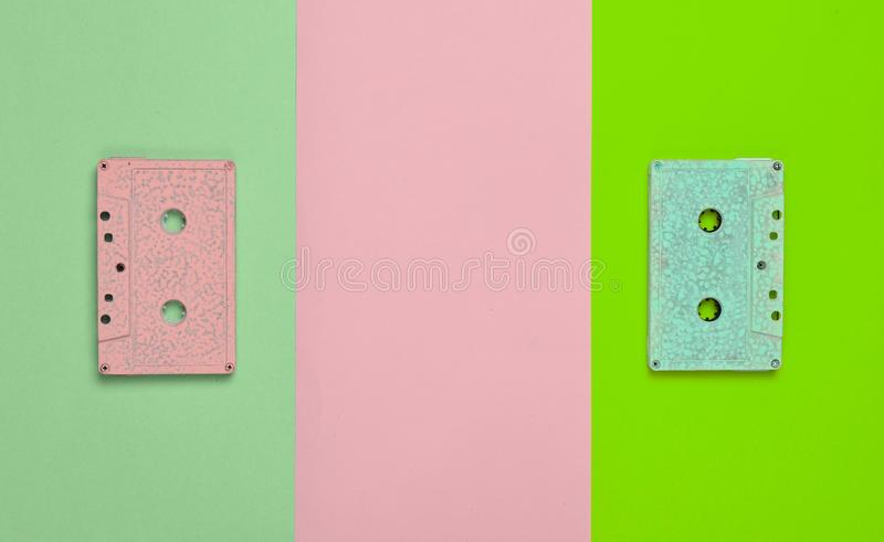 Retro audio cassette pastel color on a colored paper background. Copy space. Minimalist trend.  royalty free stock image