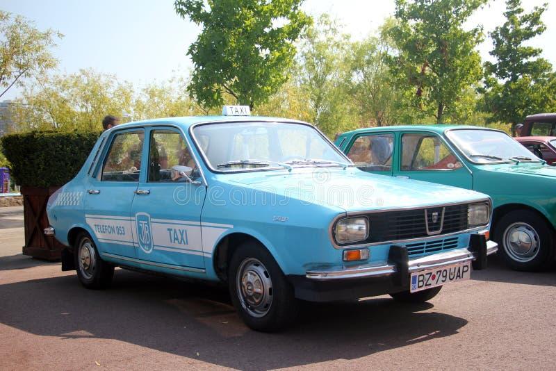 Retro automobili - vecchio taxi di Dacia fotografia stock