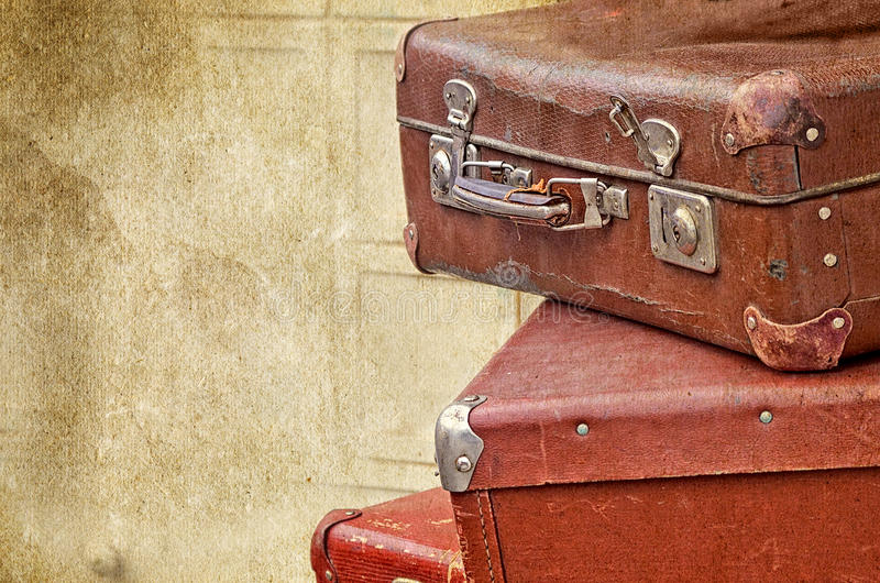 Retro bags on the old vintage textured paper background stock image