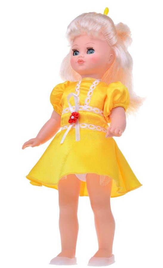 Retro bambola in vestito giallo isolato su fondo bianco fotografie stock libere da diritti