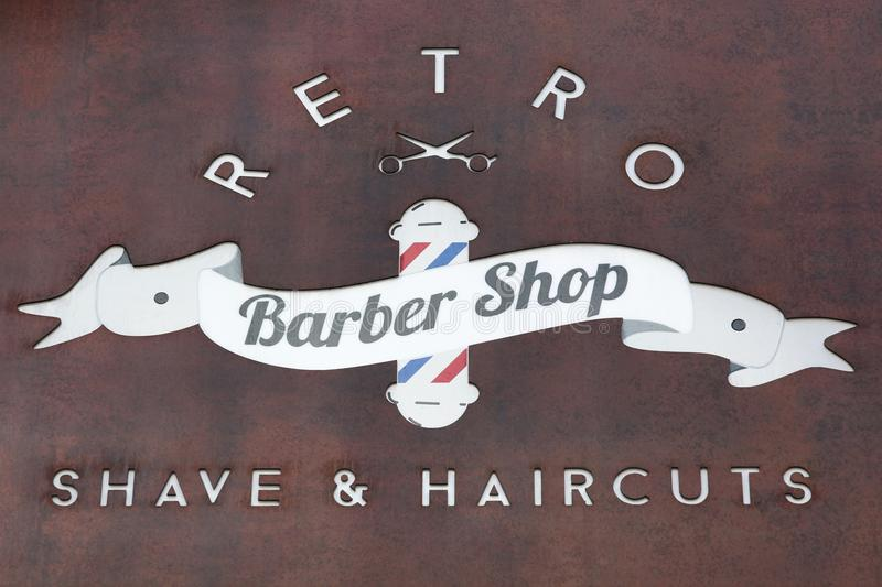 Retro barbershop sign on wall. France royalty free stock photo