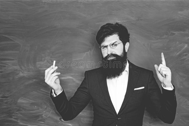 Retro bearded teacher over blackboard. Back to school and happy time. School concept. World teachers day. Professor in stock photo