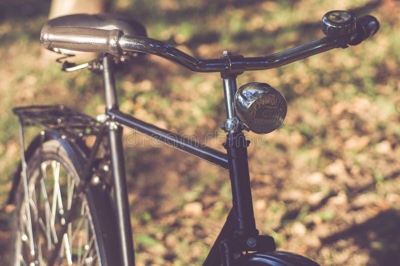 Retro Bicycle with vintage overlay. Retro Bicycle in nature with vintage overlay royalty free stock photo