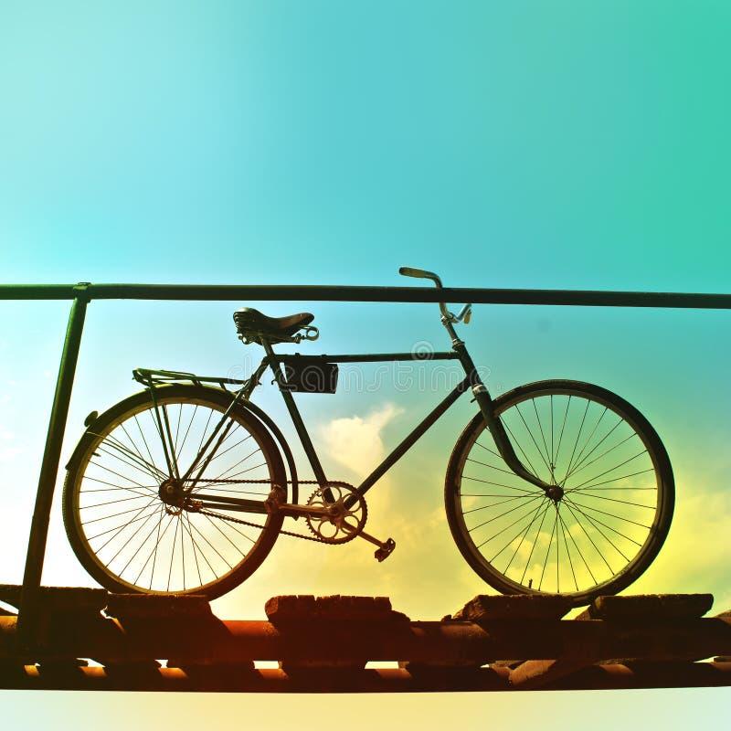 Retro bike on an old wooden bridge. stock image