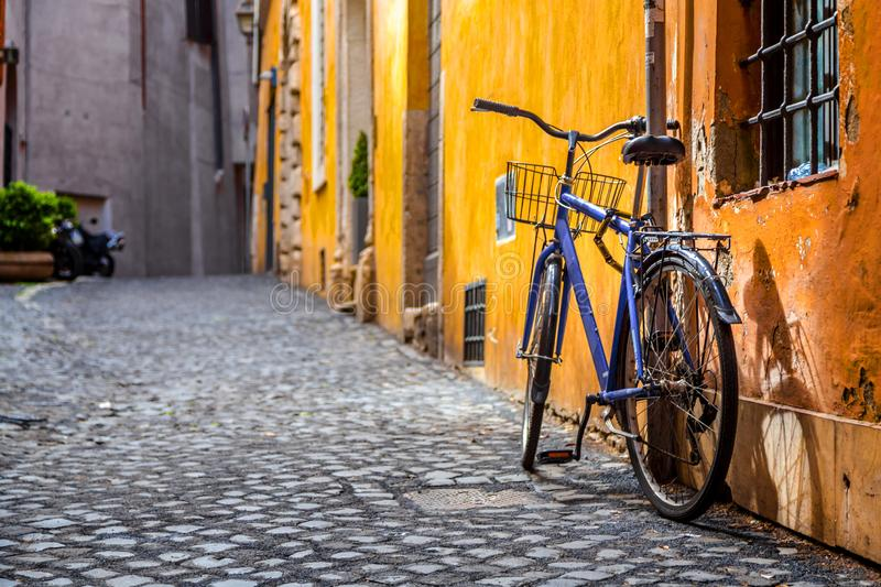 Retro bike parked in Rome. Retro bike parked in an ancient and beautiful street of Rome, the Italian capital stock image