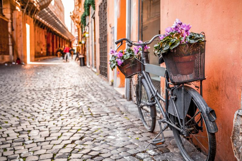 Retro bike parked in Rome. Retro bike parked in an ancient and beautiful street of Rome, the Italian capital stock images