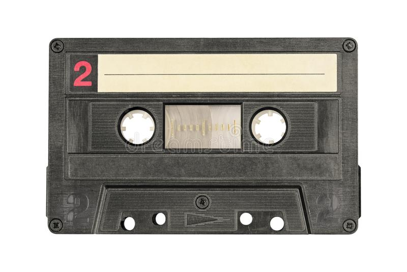 Retro black audio cassette tape isolated on white background. stock image
