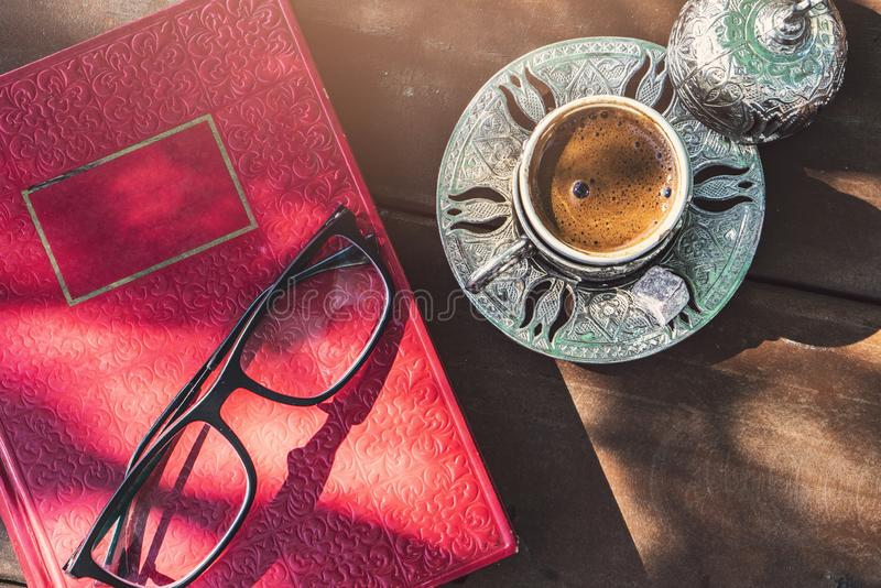 Retro books, glasses and türkish coffeee on table. Background stock photos