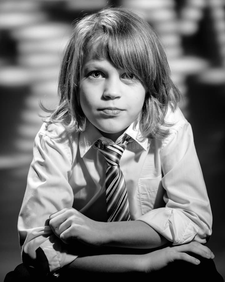 Retro boy in formalwear. Retro portrait of young teen boy posing in formalwear royalty free stock image