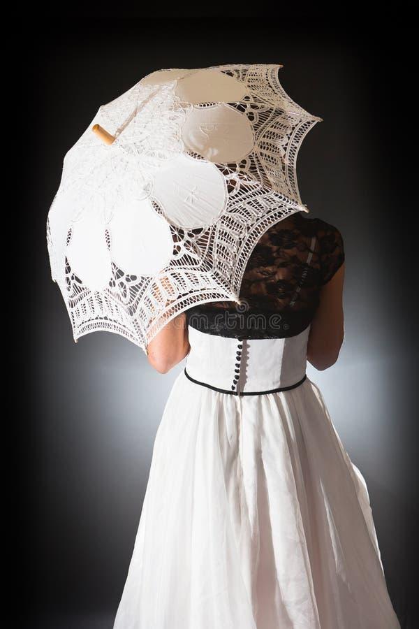 Retro bride with lace umbrella royalty free stock photo