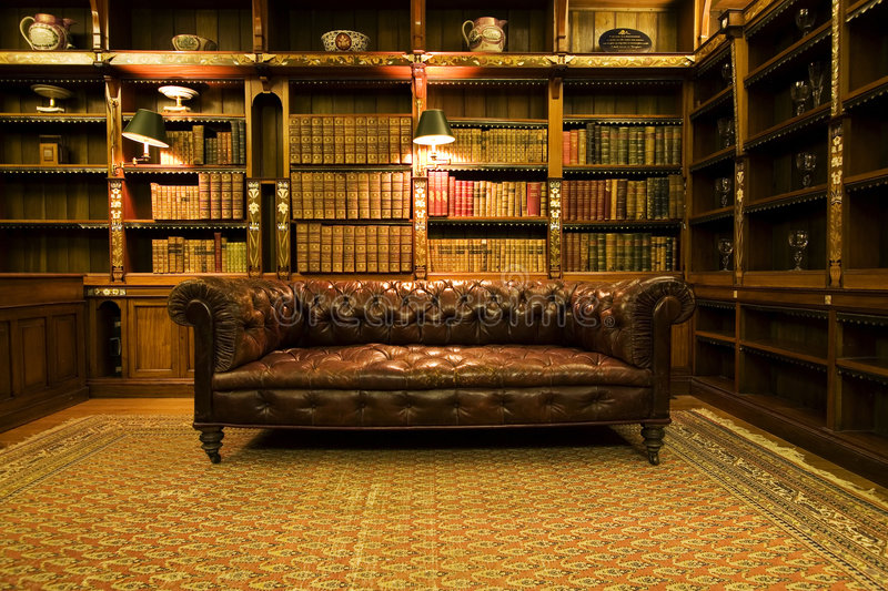 Retro brown leather couch stock photos