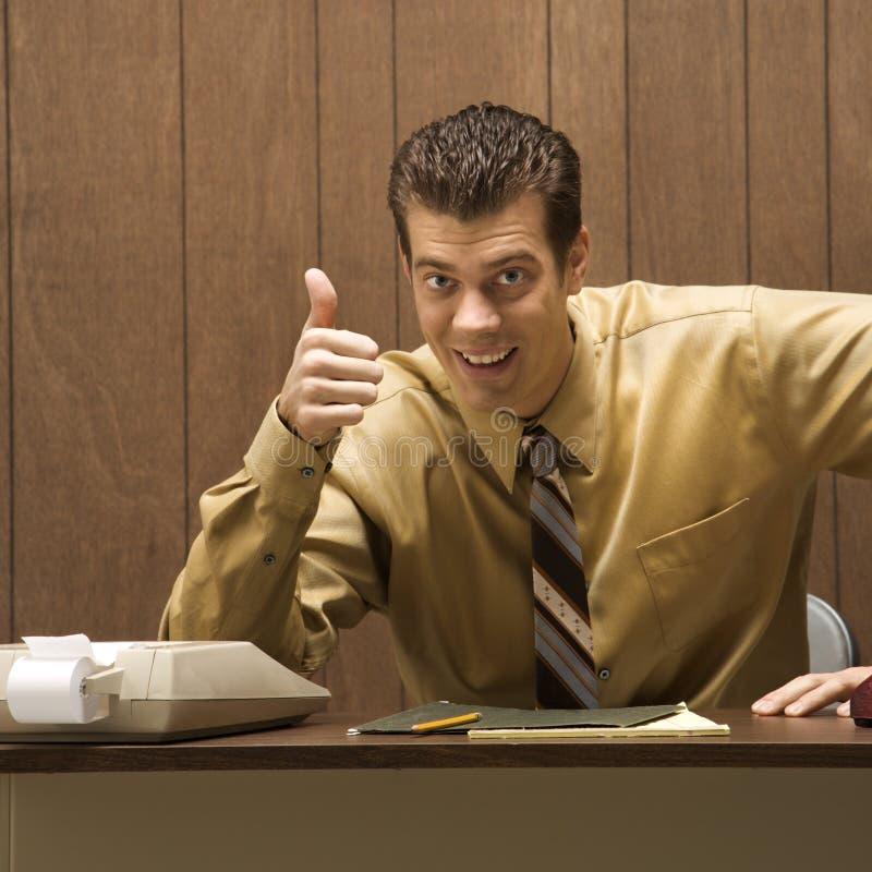 Retro business scene of man at desk. royalty free stock photo
