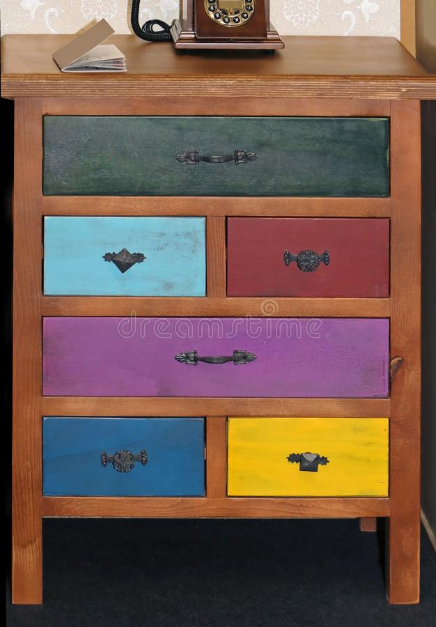 Retro cabinet with colorful drawers royalty free stock images