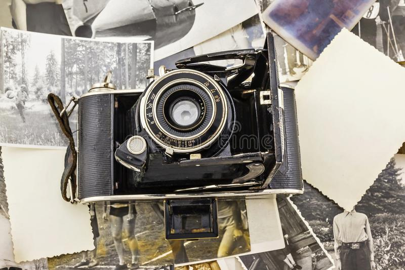 Retro camera on the background of old photos.  stock photo