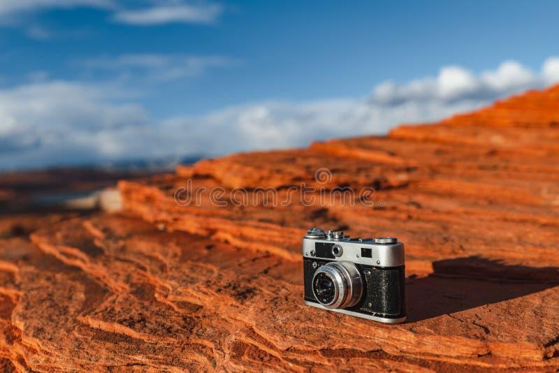 Retro camera at the canyon. Retro camera on the stone at the canyon stock photography