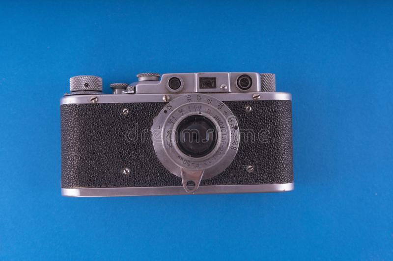 Retro camera in a flat style. Vintage camera on a colored background. Old camera with strap. Isolated antique Camera. royalty free stock photos