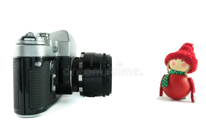 Retro camera and red doll stock image