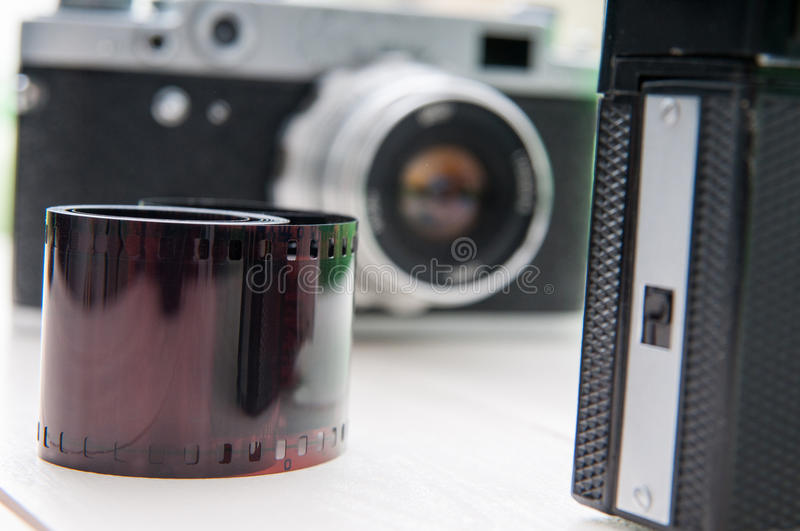 Retro cameras and film royalty free stock image