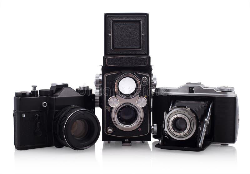 Retro cameras. Three old cameras on white background stock photo