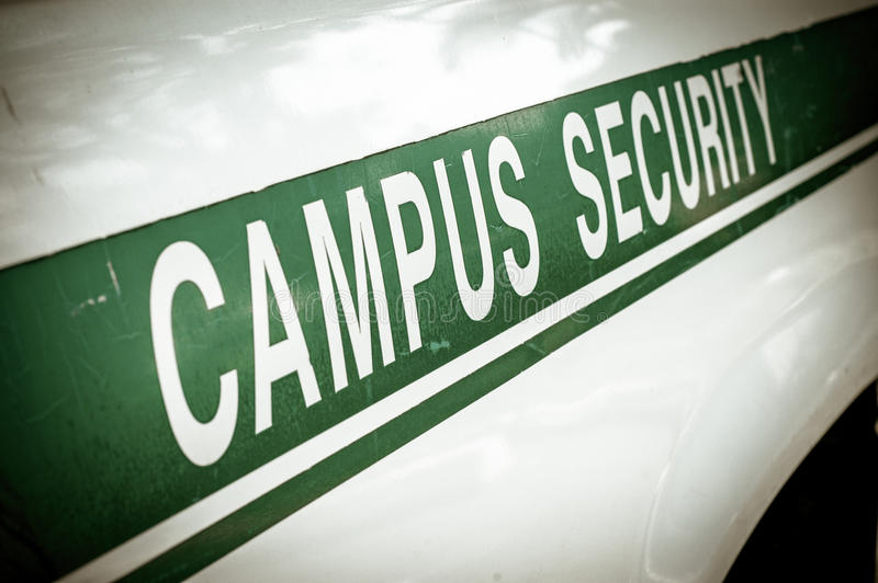 Retro Campus Security. Retro Filtered Campus Security Sign On The Side Of A University Vehicle royalty free stock photos