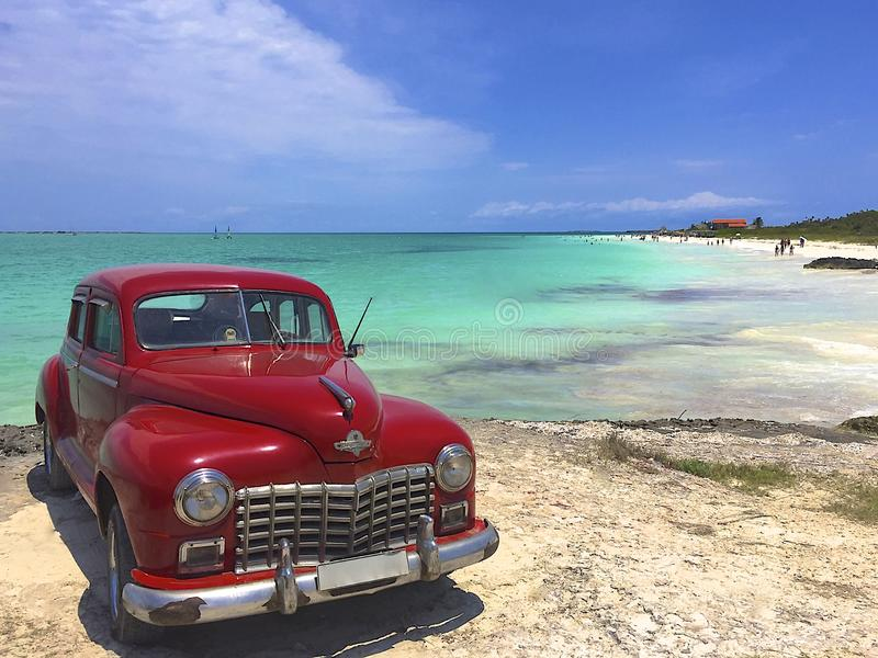 Download Retro Car On The Beach In Cuba Stock Photo