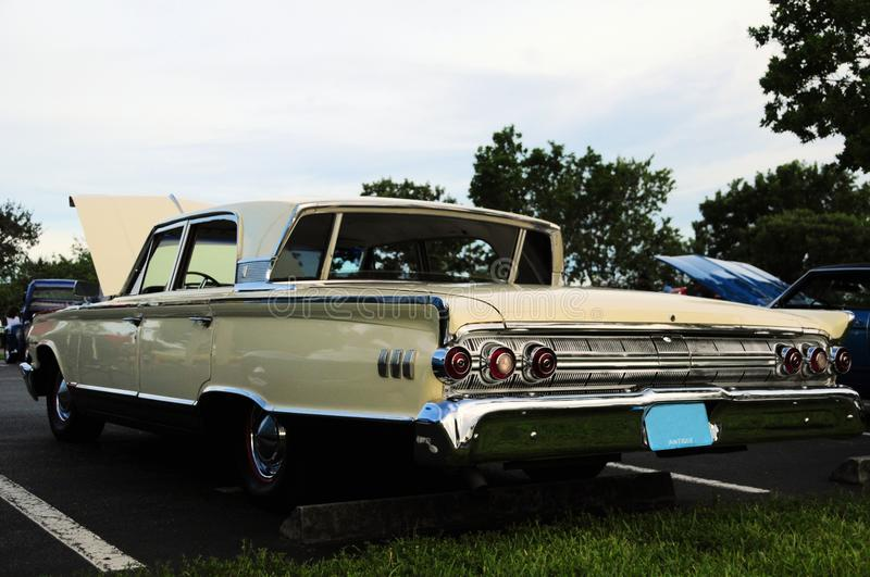 Retro car with Breezeway window. 1963 Mercury Monterey, with open hood and rear Breezeway window, parked in a South Florida parking lot stock image