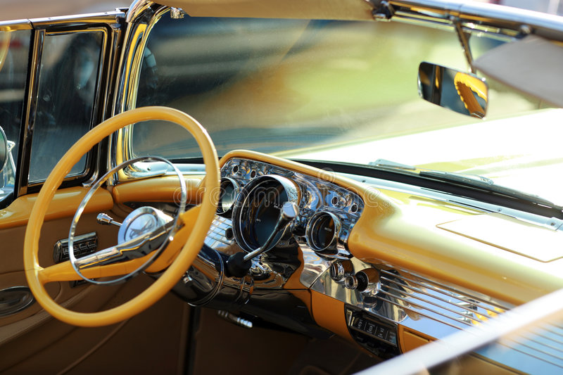 Retro car interior. Retro American car interior, yellow and chrome royalty free stock image