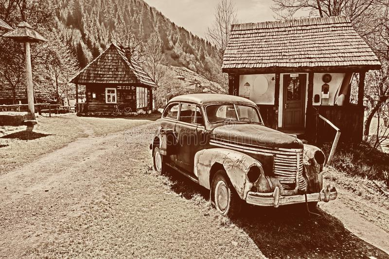 Retro car in the old village. Toned image royalty free stock photography