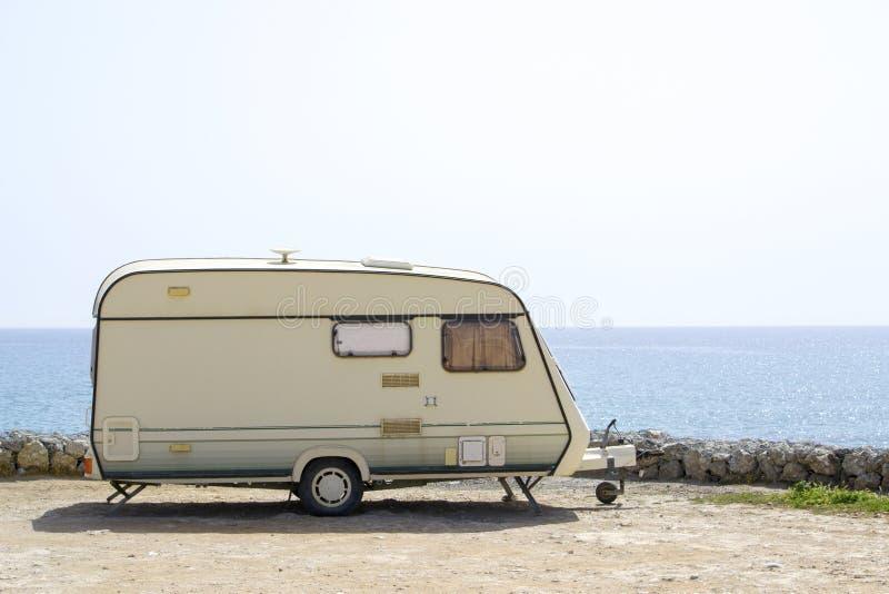 Retro caravan near the sea royalty free stock photography