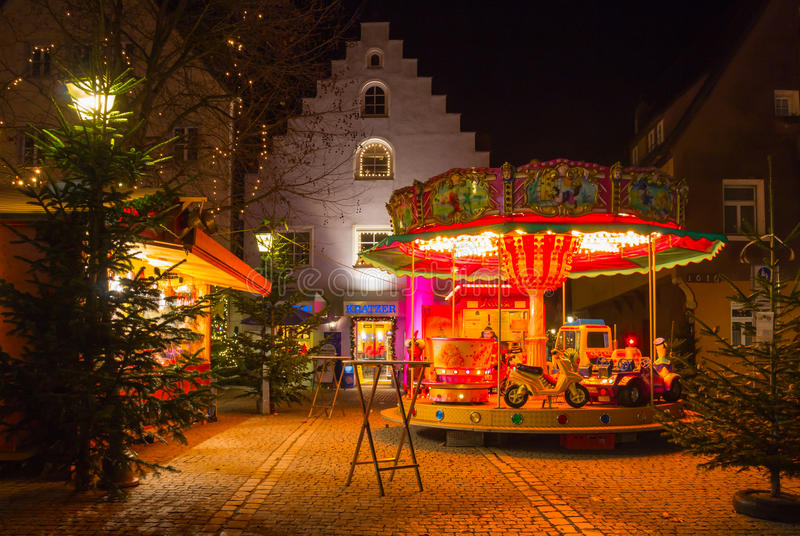 Retro carousel -Christmas bavarian town in evening. Hersbruck, Bavaria, Germany- Christmas time, evening illuminated scenery with retro merry-go-round for royalty free stock photography