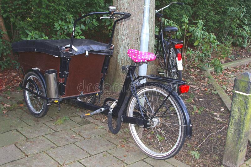 Retro tricycle for transport of children and consumer goods, Netherlands stock photos