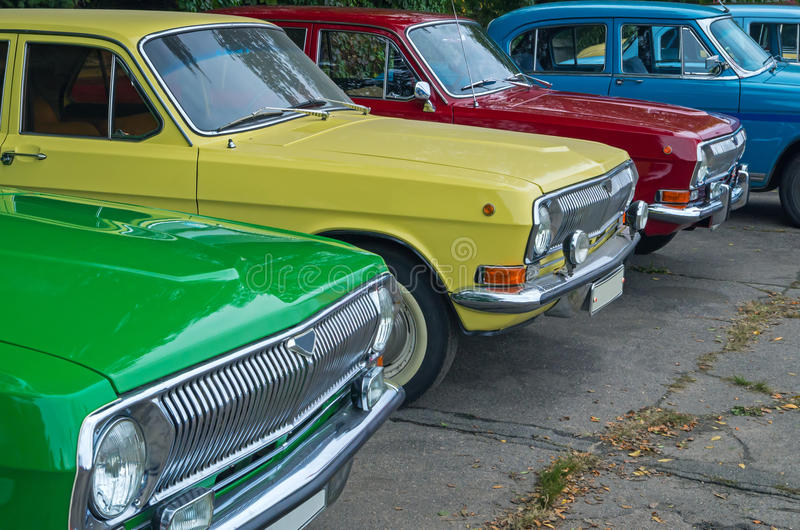 Retro cars. Vintage vehicles are in the parking lot on the city show royalty free stock photography