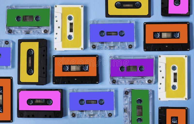 Retro cassette tape collection on blue background. royalty free stock photography