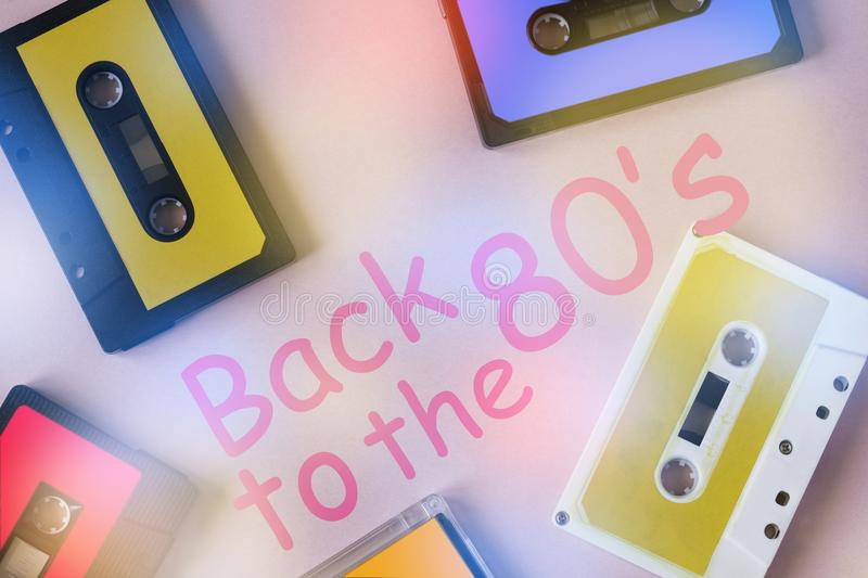 Retro cassette tape collection on pink background. stock image