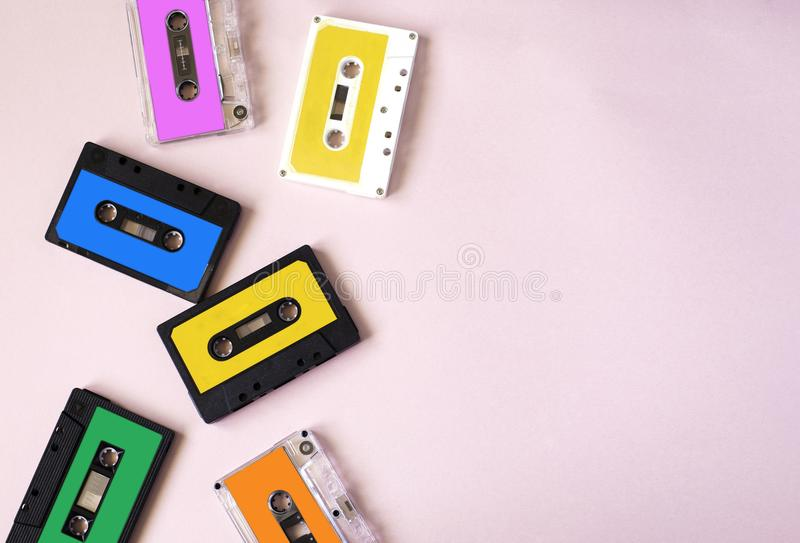 Retro cassette tape collection on pink background. stock photos
