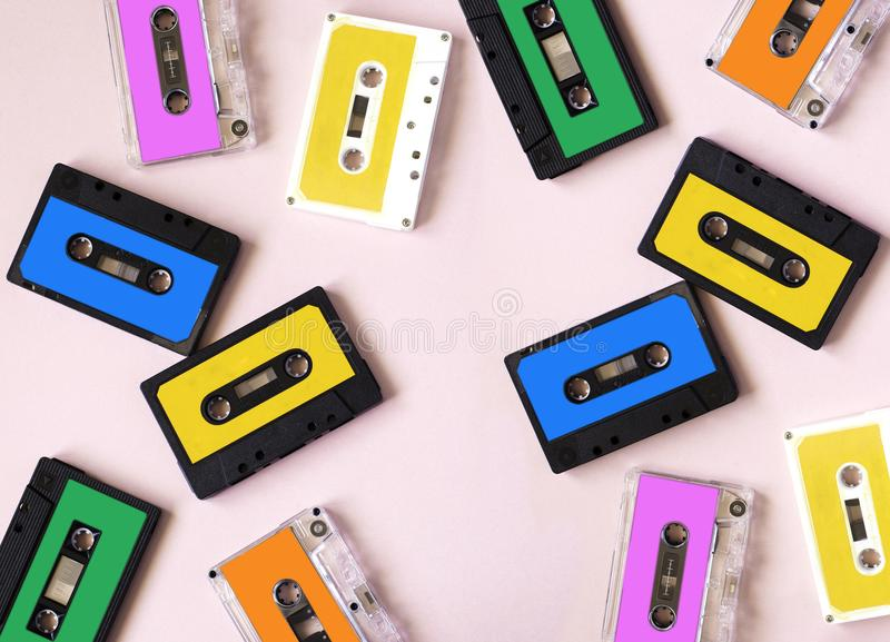 Retro cassette tape collection on pink background. stock photography