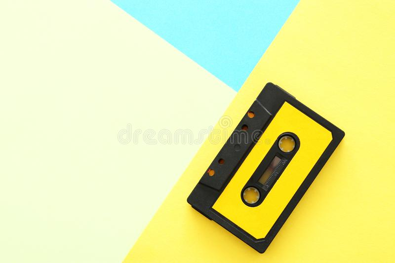 Retro cassette tape over yellow and blue double color background. top view. copy space. stock images