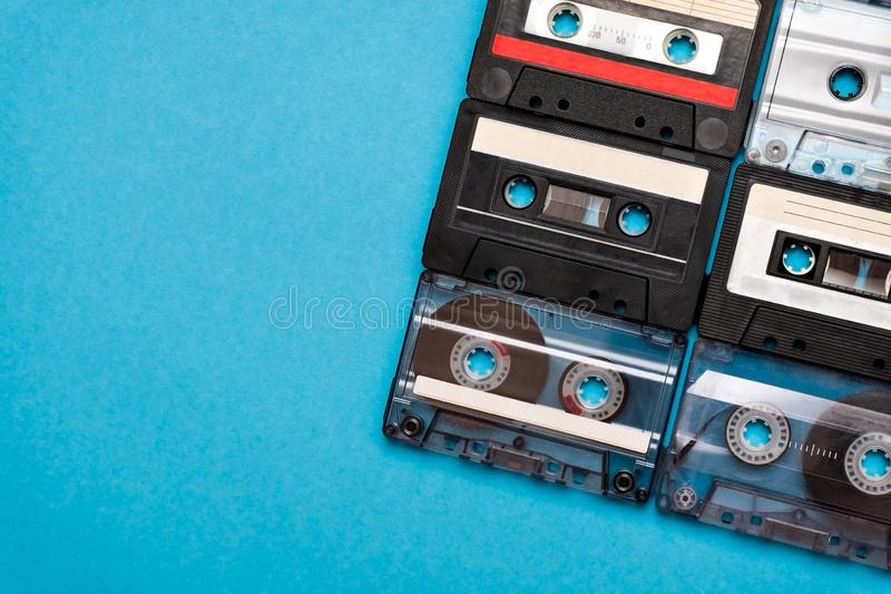 Retro cassette tapes places in blue background. royalty free stock photo