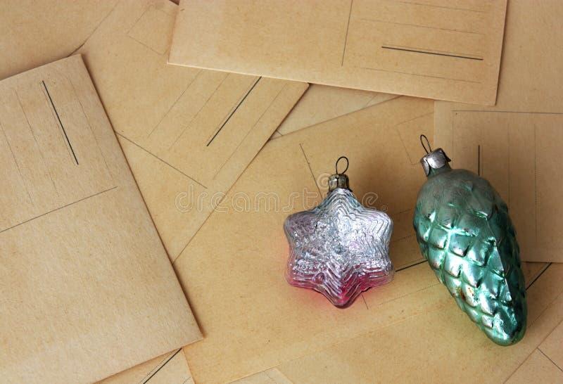 Retro christmas toys on post cards. Retro glass christmas toys on post cards royalty free stock photo
