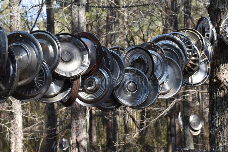 Retro Chrome Hubcaps. A collection of old retro US car chrome hubcaps royalty free stock image