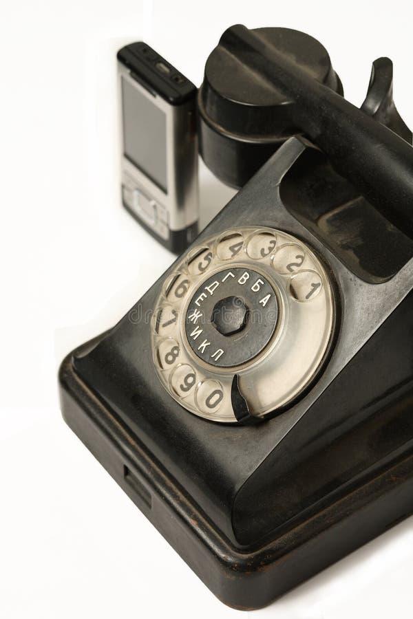 Retro classics and modern phones royalty free stock photos