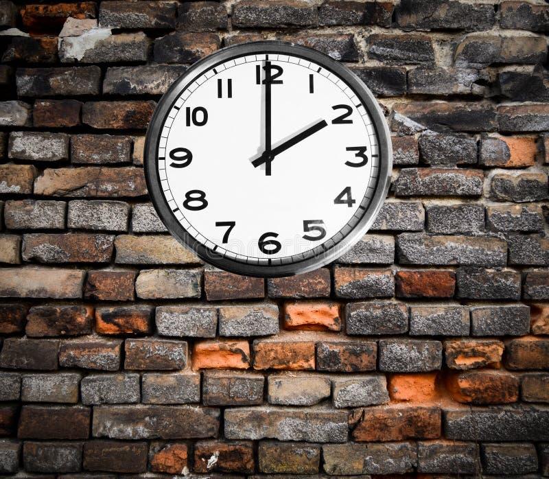 Retro clock on brick wall stock images