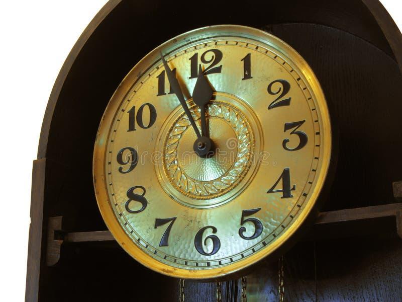 Retro clock at New Year`s midnight. Close-up of the retro clock at New Year`s midnight royalty free stock photos