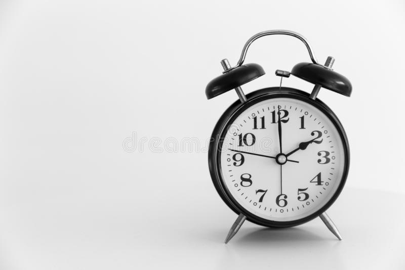 Retro clock at 2 o `clock on white background. Space for text stock image