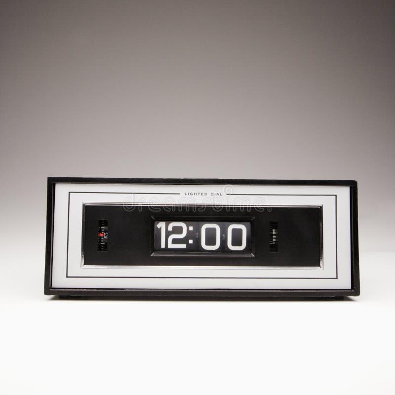 Retro clock showing 12:00. royalty free stock photo